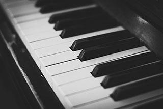 together, the piano's white and black keys communicate life's beautiful complexities