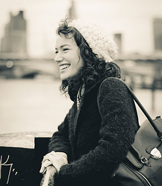 black and white photo of a smiling woman who is happy she can play piano