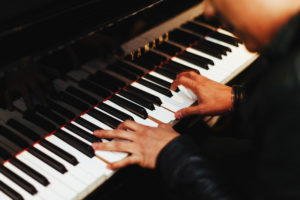 man-piano-featured