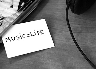 music headphones and a note that says music equals life