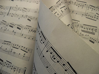 sheet music with a page turning