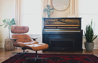 upright piano in a modern vintage style home